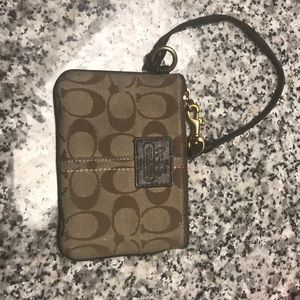 Authentic coach wristlet in brown